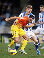 Real Sociedad's Asier Illarramendi (r) and FC Barcelona's Xavi Hernandez during La Liga match.January 19,2013. (ALTERPHOTOS/Acero) /NortePhoto