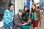 Bill Keys types up a new story for Jenny Dore, Kate McIllroy and Evelyn Dore Killorglin  at the K Fest Arts and Music festival in Killorglin on Sunday