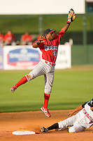 Second baseman Harold Garcia #34 of the Lakewood BlueClaws leaps for a high throw as Eduardo Escobar #2 of the Kannapolis Intimidators steals second base at Fieldcrest Cannon Stadium May 16, 2009 in Kannapolis, North Carolina. (Photo by Brian Westerholt / Four Seam Images)