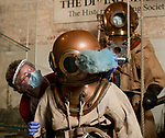 Pictured: Museum director Kevin Casey wears PPE as he dusts an 1940's Standard Dress diving suit on display at the Diving Museum in Gosport, Hants.<br /> <br /> With museums set to open this forthcoming Saturday on July 4th inline with the Governments easing of lockdown restrictions, the Diving Museum is keeping its doors closed unti April 2021. <br /> <br /> The museum cannot safely introduce social distancing measures, and as a volunteer run institution most members of staff are considered vulnerable.<br /> <br /> © Jordan Pettitt/Solent News & Photo Agency<br /> UK +44 (0) 2380 458800