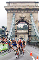 11 SEP 2010 - BUDAPEST, HUN - Stuart Hayes leads a pack off the Chain Bridge during the 2010 Elite Mens ITU World Championship Series Triathlon final (PHOTO (C) NIGEL FARROW)