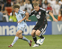 Danny Allsopp #9 of D.C. United tangles with Wells Thompson #15 of the Colorado Rapids during an MLS match on May 15 2010, at RFK Stadium in Washington D.C. Colorado won 1-0.