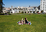 California: San Francisco. People relaxing in Alamo Square with view of Victorians and modern downtown. Photo copyright Lee Foster. Photo #: san-francisco-alamo-square-20-casanf79133