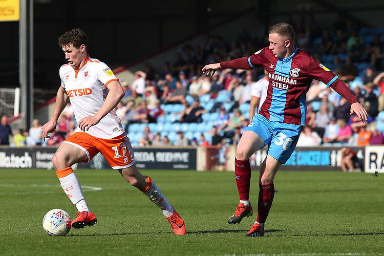 Blackpool's Matty Virtue-Thick gets away from Scunthorpe United's Jordan Hallam<br /> <br /> Photographer David Shipman/CameraSport<br /> <br /> The EFL Sky Bet League One - Scunthorpe United v Blackpool - Friday 19th April 2019 - Glanford Park - Scunthorpe<br /> <br /> World Copyright © 2019 CameraSport. All rights reserved. 43 Linden Ave. Countesthorpe. Leicester. England. LE8 5PG - Tel: +44 (0) 116 277 4147 - admin@camerasport.com - www.camerasport.com