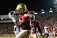 TALLAHASSEE, FL 11/19/11-FSU-UVA111911 CH-Florida State's Ja'Baris Little pulls in the Seminole's only touchdown against Virginia during first half action Saturday at Doak Campbell Stadium in Tallahassee. .COLIN HACKLEY PHOTO