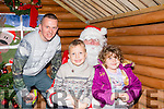 Meet Santa<br /> ---------------<br /> Paul Galloway from Ballyheigue with his two children Holly&amp;Dylan get to meet Santa at the community centre last Sunday evening during the village annual Bazaar.