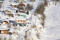Aerial of Sled Dog Team Arriving @ Takotna Chkpt Iditarod 2005