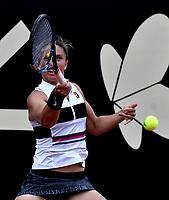BOGOTÁ-COLOMBIA, 12-04-2019: Sara Errani de Italia, devuelve la bola a Astra Sharma de Australia, durante partido por el Claro Colsanitas WTA, que se realiza en el Carmel Club en la ciudad de Bogotá. / Sara Errani of Italy, returns the ball against Astra Sharma of Australia, during a match for the WTA Claro Colsanitas, which takes place at Carmel Club in Bogota city. / Photo: VizzorImage / Luis Ramírez / Staff.<br />  / Photo: VizzorImage / Luis Ramírez / Staff.