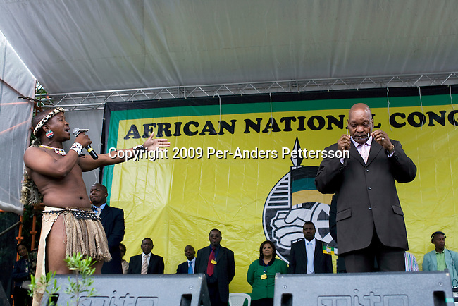 PIETERMARITZBURG, SOUTH AFRICA FEBRUARY 4: A traditional praise singer introduces ANC president Jacob Zuma at a rally after he appeared in court on February 4, 2009 in Pietermaritzburg, South Africa. Jacob Zuma appeared in court and a court date was set for August 2009. Mr. Zuma was recently cleared of charges and he is expected to win the general election on April 22, and become South Africa's third democratic president. (Photo by Per-Anders Pettersson)....