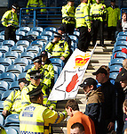 Police check the banners before giving them the all clear