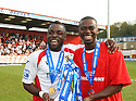 Yemi Odubade and Eddie Odhiambo of Stevenage Borough  celebrate with the Blue Square Premier championship trophy after the Blue Square Premier match between Stevenage Borough and York City at the Lamex Stadium, Broadhall Way, Stevenage on Saturday 24th April, 2010..© Kevin Coleman 2010 ..
