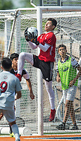 NWA Democrat-Gazette/BEN GOFF @NWABENGOFF<br /> Eric Flores, Fort Smith Northside goalkeeper, makes a save against Springdale Saturday, May 12, 2018 during the semifinal match in the boys 7A state soccer tournament in Gates Stadium at Rogers Heritage.