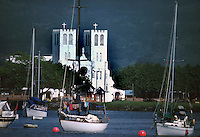 Cathedral of Apia. In the foreground, yachts and washing hanging in the rigging, Apia harbour, Samoa, USA,1980