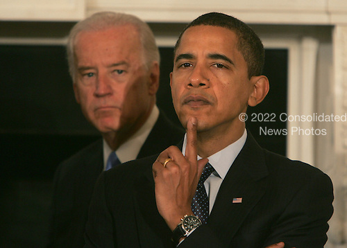 Washington, DC - February 23, 2009 -- United States President Barack Obama and Vice President Joseph Biden look thoughtful before President Obama addresses the National Governors Association (NGA) in the State Dining Room of the White House on Monday, February 23, 2009. .Credit: Dennis Brack - Pool via CNP