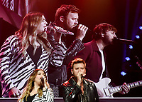 NWA Democrat-Gazette/CHARLIE KAIJO Lady Antebellum performs during the Walmart shareholders meeting, Friday, June 7, 2019 at the Bud Walton Arena in Fayetteville.