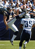 Sept. 17, 2006; San Diego, CA, USA; San Diego Chargers punter (5) Mike Scifres punts the ball against the Tennessee Titans at Qualcomm Stadium in San Diego, CA. Mandatory Credit: Mark J. Rebilas
