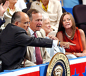 New York, NY - September 1, 2004 --   Former New York Mayor Rudy Giuliani, left, points out a supporter to former United States President George H.W. Bush, left center, at the 2004 Republican Convention in Madison Square Garden in New York, New York on Wednesday, September 1, 2004. With them are former first lady Barbara Bush, right center, and Judi Giuliani, right..Credit: Ron Sachs / CNP.(RESTRICTION: No New York Metro or other Newspapers within a 75 mile radius of New York City)