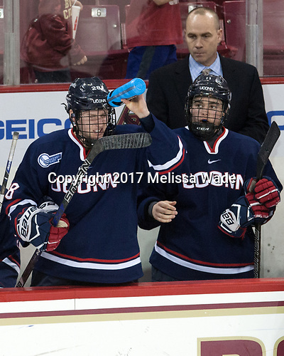 Brian Morgan (UConn - 28), Mike Cavanaugh (UConn - Head Coach), Corey Ronan (UConn - 11) - The Boston College Eagles defeated the visiting UConn Huskies 2-1 on Tuesday, January 24, 2017, at Kelley Rink in Conte Forum in Chestnut Hill, Massachusetts.