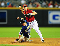 Sept. 1, 2010; Phoenix, AZ, USA; Arizona Diamondbacks shortstop Stephen Drew throws to first base after forcing out San Diego Padres baserunner Aaron Cunningham in the ninth inning at Chase Field. The Diamondbacks defeated the Padres 5-2. Mandatory Credit: Mark J. Rebilas-
