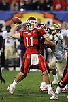 1/1/05 -- Photo by Gene Lower / Slingshot -- Utah quarterback Alex Smith scrambles sits in the pocket and looks for a reciever downfield. The Utes won the Fiesta Bowl 35 - 7 against the Pittsburgh Panthers in Phoenix, AZ on 1/1/05.