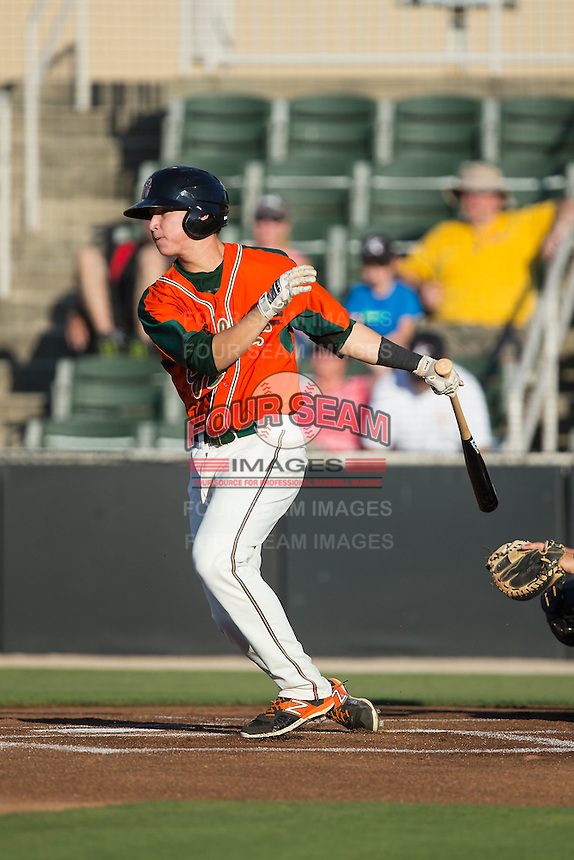 Brian Schales (43) of the Greensboro Grasshoppers follows through on his swing against the Kannapolis Intimidators at CMC-Northeast Stadium on June 11, 2015 in Kannapolis, North Carolina.  The Intimidators defeated the Grasshoppers 7-6.  (Brian Westerholt/Four Seam Images)
