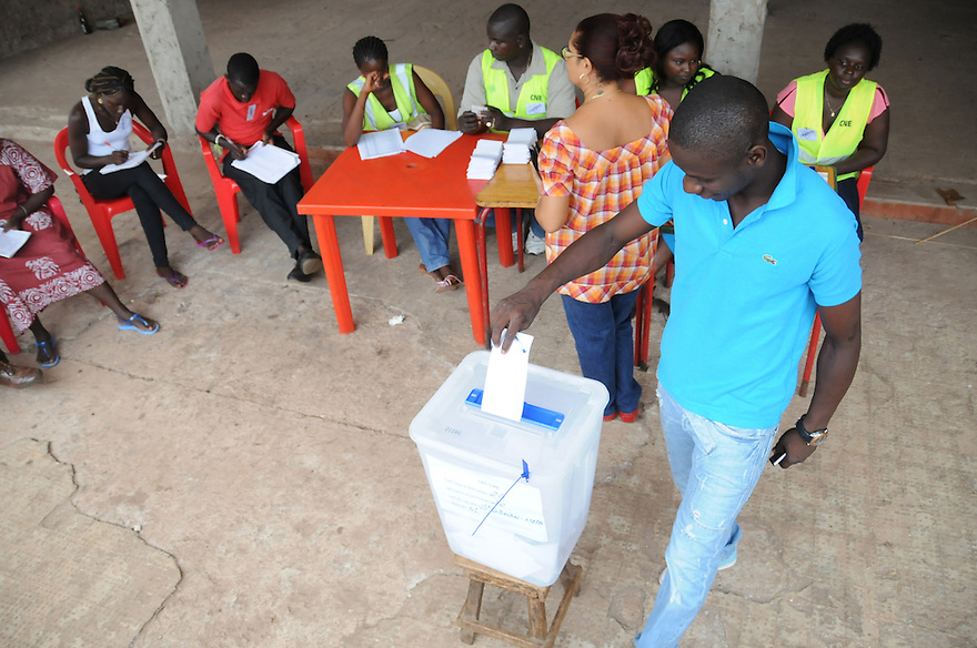Bissau/June 28 - A voter in Guinea-Bissau casts his ballot in the country's presidential election on June 28. The election comes four months after the leader João Bernardo Vieira was killed by mutinous troops...
