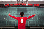 © Joel Goodman - 07973 332324 . 27/01/2014 . Manchester , UK . DANIEL LEE (23, from Hong Kong and studying at Warwick University) (correct) poses with his new shirt in front of Old Trafford . Fans with new MATA 8 shirts in front of Old Trafford Football Ground as it's announced that Spaniard Juan Mata ( Juan Manuel Mata García ) has signed for Manchester United  . Photo credit : Joel Goodman