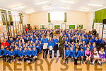 Members of the Defence Forces Lt Denis Sheahan and Gunner Mark Coffey present  the Irish flag and the proclamation to Nelly Osehi, Molly Quane  Paula Clifford, Pupils and Staff at Presentation  Primary School on Tuesday to  commemorate the 100 year anniversary.