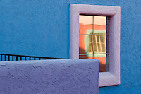 window reflection and blue wall in colorful La Placitas Village.