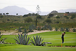 "A woman plays to the golf in  ""Desert Spring"" new urbanization placed in one of the zones with major problem of Spain's water, in Cuevas de Almanzora, near Almeria, 04 Juny 2006. AFP PHOTO/Pedro ARMESTRE"