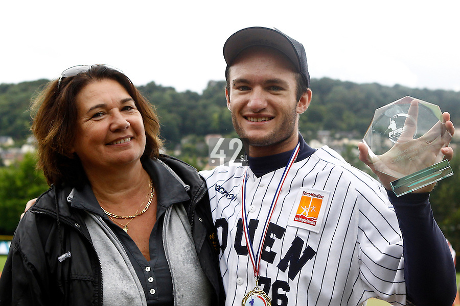 17 July 2011: Joris Bert of the Rouen Huskies poses with the best hitter trophy next to Sylvie Becquey during the 2011Challenge de France final match won 6-4 by the Rouen Huskies over the Savigny Lions, at Stade Pierre Rolland, in Rouen, France.