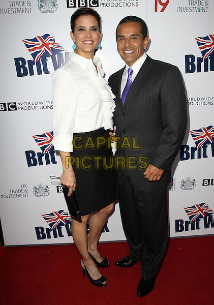 LU PARKER & ANTONIO VILLARAIGOSA, Mayor of Los Angeles.The BritWeek 2010 Champagne Launch held At The British General Consul Residence, Los Angeles, California, USA..April 20th, 2010.full length white shirt grey gray suit black skirt couple .CAP/ADM/KB.©Kevan Brooks/AdMedia/Capital Pictures.