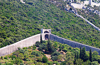 The Ston fortress built in the 14th century, and part of the 5 km long wall. Peljesac Peninsula. Ston. Peljesac peninsula. Dalmatian Coast, Croatia, Europe.