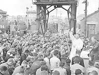 Father (Major) Edward J. Waters, Catholic Chaplain from Oswego, New York, conducts Divine Services on a pier for members of the first assault troops thrown against Hilter's forces on the continent.  Weymouth, England.  June 6, 1944.  (Army)<br /> NARA FILE #:  111-SC-190504<br /> WAR & CONFLICT BOOK #:  1039
