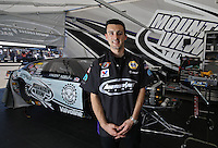 Apr. 5, 2013; Las Vegas, NV, USA: (Editors note: Special effects lens used in creation of this image) NHRA pro stock driver Vincent Nobile poses for a portrait during qualifying for the Summitracing.com Nationals at the Strip at Las Vegas Motor Speedway. Mandatory Credit: Mark J. Rebilas-