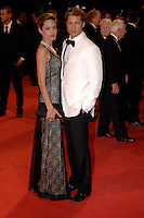 ANGELINA JOLIE &amp; BRAD PITT<br /> &quot;The Assassination of Jesse James by the Coward Robert Ford&quot; Film Premiere during the 64th Venice International Film Festival, Venice, Italy,<br /> 2nd September 2007.<br /> full length long black lace layered dress maxi clutch bag pearl necklace couple cream white tuxedo jacket shirt suit black trousers bow tie<br /> Ref: CAP/PL<br /> &copy;Phil Loftus/Capital Pictures /MediaPunch ***NORTH AND SOUTH AMERICAS ONLY***