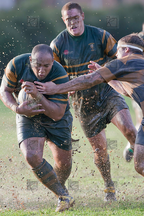 falakiko Balahame protects the ball as he makes a run past Peter Hale. Counties Manukau Premier Club Rugby game between Pukekohe and Bombay played in very wet conditions at Colin Lawrie Fields Pukekohe on Saturday 18th June 2011. Pukekohe won 61 - 0 after leading 31 - 0 at halftime.