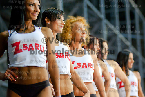 Competitors line up in their fitness dresses during the Miss Zsaru (Miss Cop) contest in Budapest, Hungary on May 13, 2012. ATTILA VOLGYI