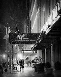 Walking on a winter night in Downtown Dayton Ohio. Black and white photo shows the Loft.