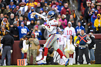 Landover, MD - December 9, 2018: New York Giants quarterback Eli Manning (10) throws a touchdown late in the second half of game between the New York Giants and Washington Redskins at FedEx Field in Landover, MD. The Giants defeated the Redskins 40-16 dropping the Redskins to 6-7 on the season. (Photo by Phillip Peters/Media Images International)