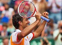 14-07-13, Netherlands, Scheveningen,  Mets, Tennis, Sport1 Open, day seven final, Jesse Huta Galung (NED) wins and jubilates.<br /> <br /> <br /> Photo: Henk Koster