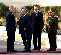 Baghdad, Iraq - December 14, 2008 -- President Jalal Talabani of Iraq greets United States President George W. Bush shortly after arriving at Salam Palace on Sunday, December 14, 2008. Bush is on his final visit to Iraq before the end of his second presidential term to meet with Iraqi leaders and sign a ceremonial copy of the security agreement. <br /> CAP/MPI/CNP/RS<br /> &copy;RS/CNP/MPI/Capital Pictures
