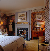 The bedroom is decorated with vintage Indonesian batiks around a stainless steel grate lined with blue and green tiles