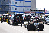 Sept. 15, 2012; Concord, NC, USA: NHRA crew members for top fuel dragster driver Shawn Langdon wait in the staging lanes during qualifying for the O'Reilly Auto Parts Nationals at zMax Dragway. Mandatory Credit: Mark J. Rebilas-