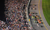 Feb 9, 2008; Daytona, FL, USA; Nascar Sprint Cup Series driver Dale Earnhardt Jr (88) leads the field through the tri-oval on the last lap to win the Bud Shootout at Daytona International Speedway. Mandatory Credit: Mark J. Rebilas-US PRESSWIRE