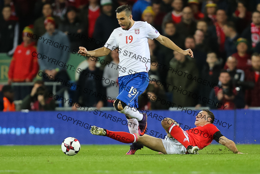 (copyright &amp; photo: STARSPORT)<br /> 12.11.16 - Wales v Serbia, FIFA World Cup Qualifier 2018 - Nikola Maksimovic of Serbia is challenged by James Chester of Wales