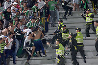 IBAGUÉ -COLOMBIA, 13-12-2014. Hinchas de Atletico Nacional formaron distubios en las tribunas durante el encuentro con Deportes Tolima por la fecha 4 de la Liga Aguila I 2016 jugado en el estadio Manuel Murillo Toro de la ciudad de Ibagué./ Fans of Atletico Nacional made a riots on the tribune during a match with Deportes Tolima for the date 4 of the Aguila League I 2016 played at Manuel Murillo Toro stadium in Ibague city. Photo: VizzorImage / Juan Carlos Escobar / Str