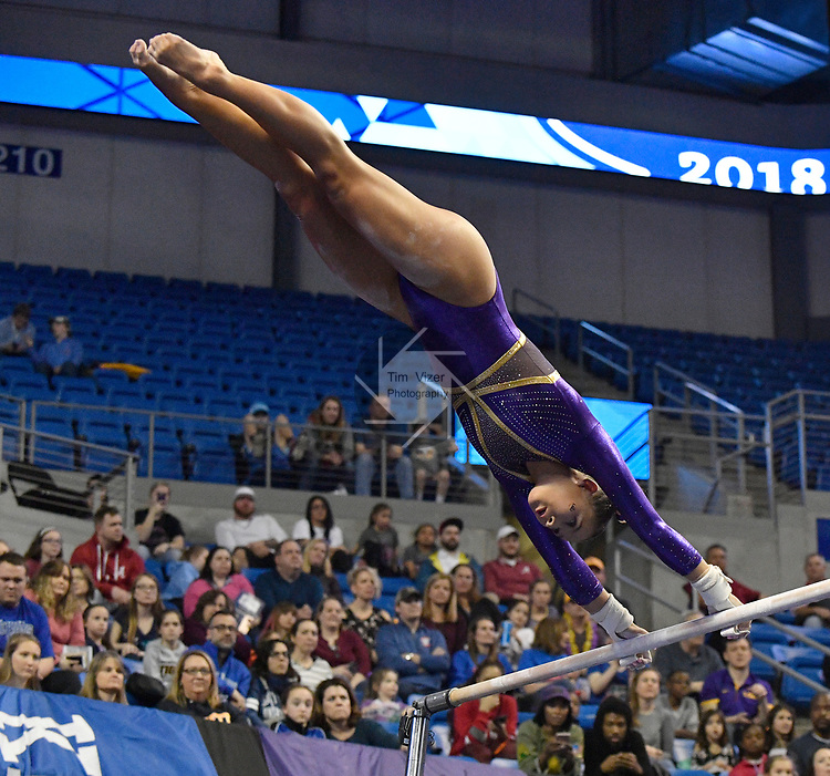 The SEC National Gymnastic Championship was held on Saturday March 24 at Chaifetz Arena on the Saint Louis University campus. Sarah Finnegan competes on the uneven bars.<br />Photo by Tim Vizer