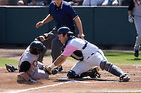 August 30, 2009: Everett AquaSox catcher Trevor Coleman tags out Salem-Keizer Volcanoes' Joel Weeks at the plate during a Northwest League game at Everett Memorial Stadium in Everett, Washington.  The AquaSox wore pink jerseys for breast cancer awareness.
