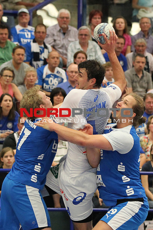 04.09.2013, Klingenhalle Solingen, Solingen, GER, HBL,  Bergischer HC vs HSV Handball, im Bild<br /> Zarko Markovic (Hamburg #77 / MNT) (mi.) gegen Jan Artmann (Bergischer HC #17) (li.) und Emil Berggren (Bergischer HC #29 / SWE) (re.)<br /> <br /> Foto &copy; nph / Mueller